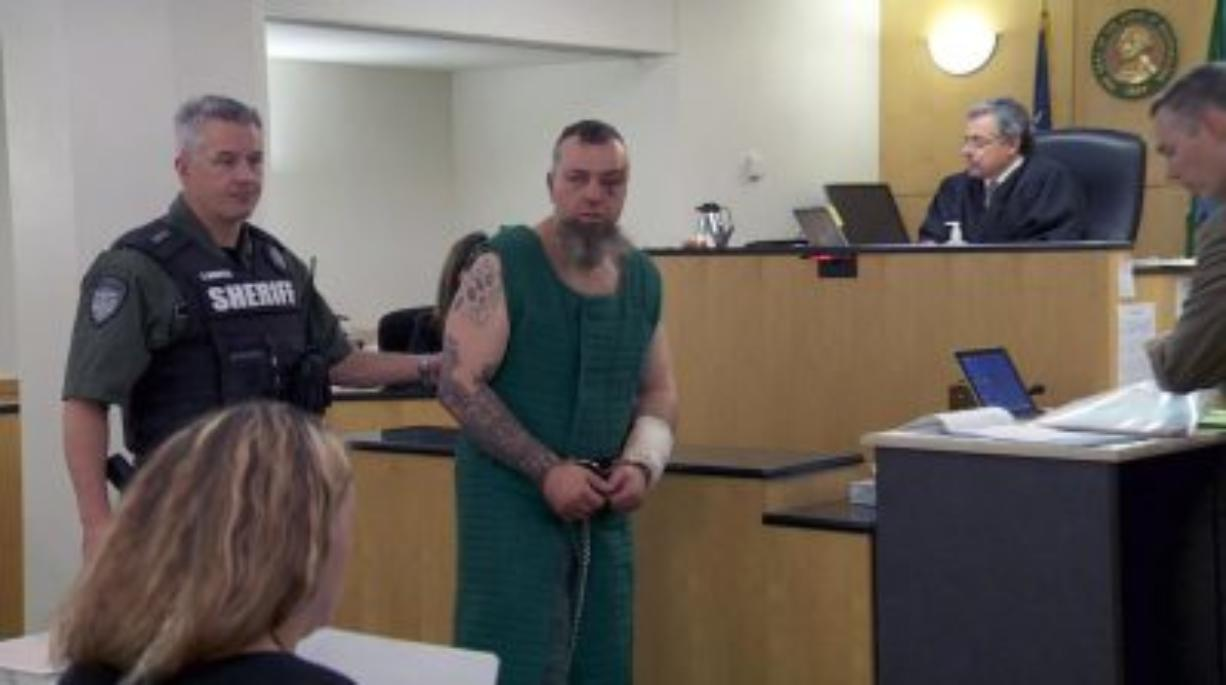 Michael J. Boyd, 42, appears Wednesday in Clark County Superior Court after allegedly assaulting a Washington State Patrol trooper and punching a Vancouver K-9 on Tuesday. (KATU News)
