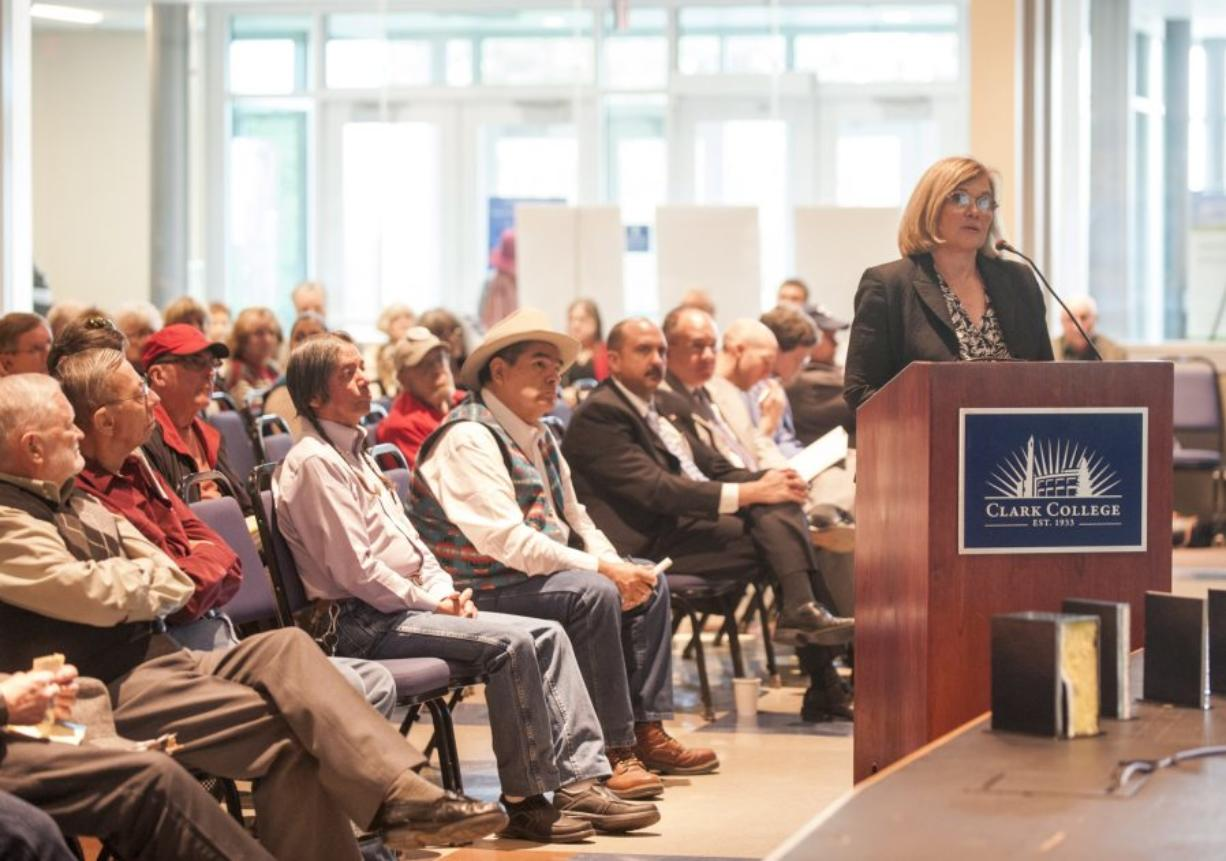 State Rep. Sharon Wylie, D-Vancouver, urges the Port of Vancouver commissioners to deny an oil terminal lease amendment and altogether cancel it during a daylong hearing Tuesday at Clark College.