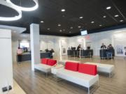 Comcast employees and customers interact in the company's new Vancouver Plaza store, which opened Monday. The Xfinity Store is part of Comcast's new approach to customer service.