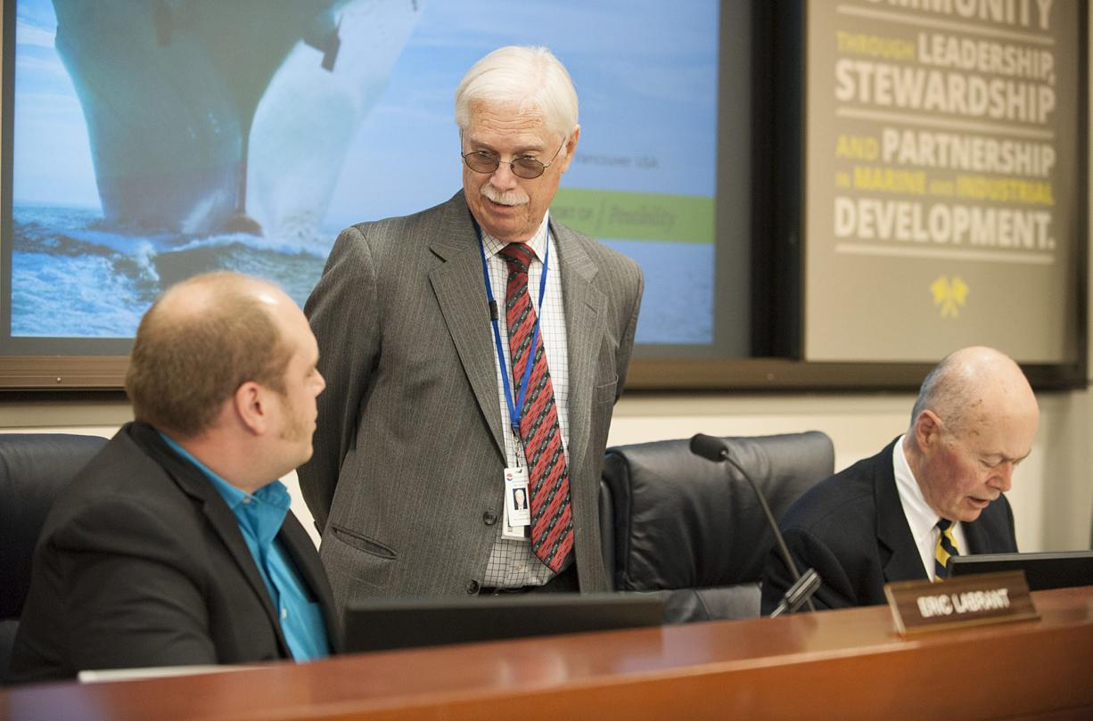 Port Commissioners Eric LaBrant, from left, and Brian Wolfe chat before the meeting as fellow Commissioner Jerry Oliver works nearby Friday afternoon, April 15, 2016 at the Port of Vancouver.