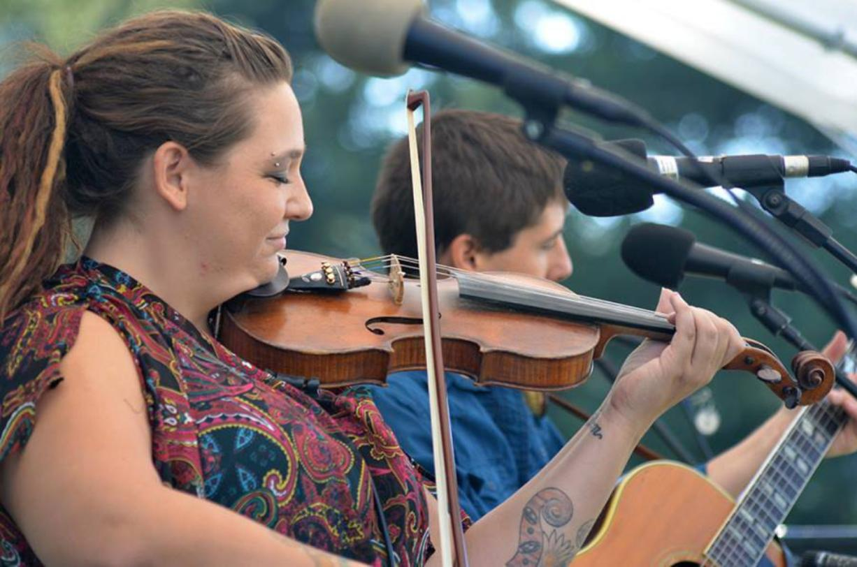 Aarun Carter plays fiddle on stage with Jonathan Trawick at the Clark County Folk Festival.