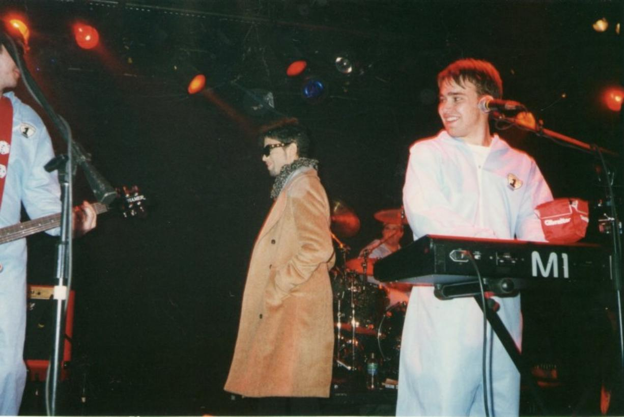 """Prince, then known as The Artist Formerly Known as Prince, takes the stage to perform """"Raspberry Beret"""" with '80s cover band The Cheesebrokers on Jan. 18, 1997, in Birmingham, Ala (Courtesy of Michael Green)"""