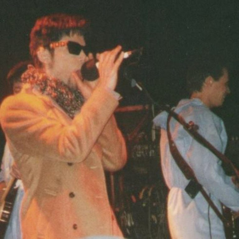 """Prince, then known as The Artist Formerly Known as Prince, performs """"Raspberry Beret"""" with 1980s cover band The Cheesebrokers on Jan. 18, 1997, in Birmingham, Ala. At right, Michael Green, now a Vancouver defense attorney, plays bass. (Courtesy of Michael Green)"""