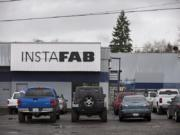 Cars are parked outside Instafab on a Monday morning in February in Vancouver.