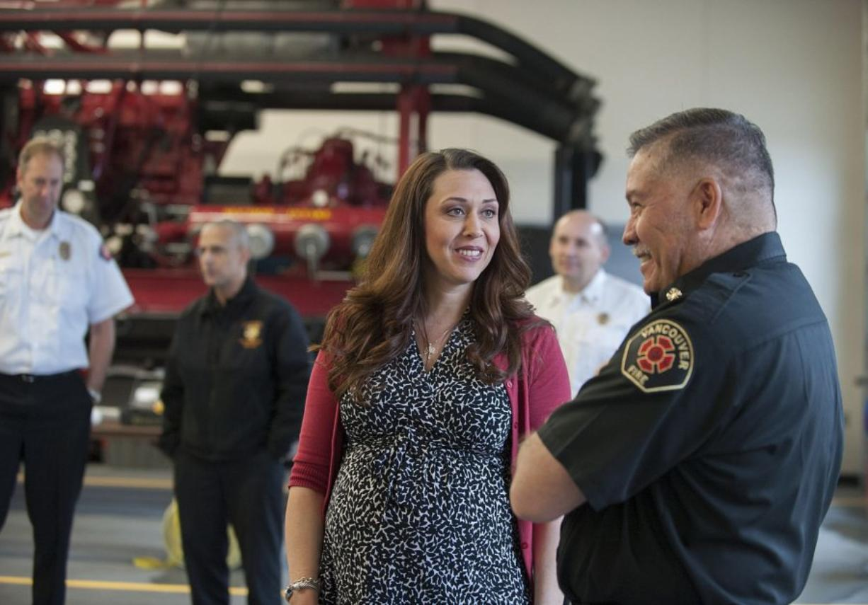 U.S. Rep. Jaime Herrera Beutler, R-Camas, chats with Vancouver Fire Chief Joe Molina on April 22 at the Vancouver Fire Department station in northeast Vancouver.