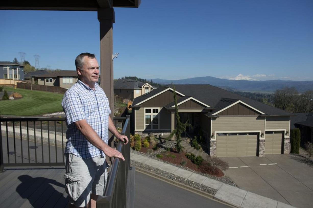 Bill Campbell takes in the view from his deck. He said he thinks the government should bury the proposed high-voltage power line to preserve views and property values, and to protect the environment.