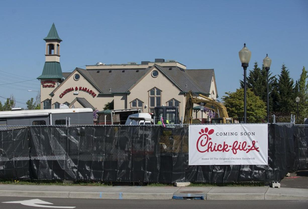 Construction continues Friday morning at the intersection of S.E. Mill Plain Boulevard and S.E. 164th Avenue where Vancouver's first Chick-fil-A is being built.