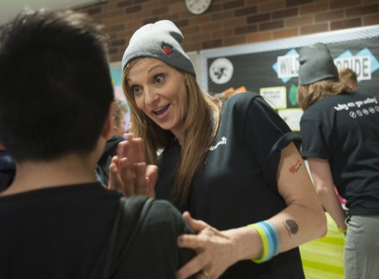 """Leanne Reid communicates the new """"Weed Can Wait"""" message as part of a kickoff event at Vancouver's Discovery Middle School Wednesday."""
