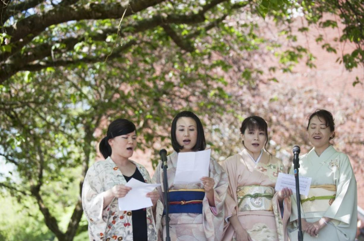 "Vocalists Tomoko Parsons, from left, Maki Polley, Saichko Mizunoya and Yukiko Vossen sing the ""Song of Spring"" at Clark College's annual Sakura Festival on Thursday. (Photos by Natalie Behring/The Columbian)"