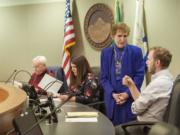 Salary Review Commission members Barry Hemphill, from left, Magan Reed, MarCine Miles and Thomas Hackett gather before the meeting Friday morning, April 15, 2016 at City Hall.
