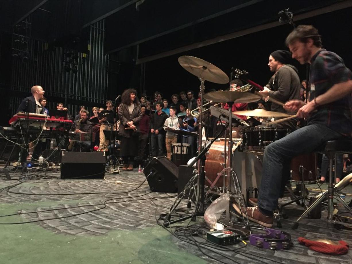 Behind the red electric piano at left is Luke Wyland directing the Camas High School choir as his own band, AU, grooves along. At center is guest singer Holland Andrews, also known as Like a Villain. (Courtesy of the Camas High School choir)