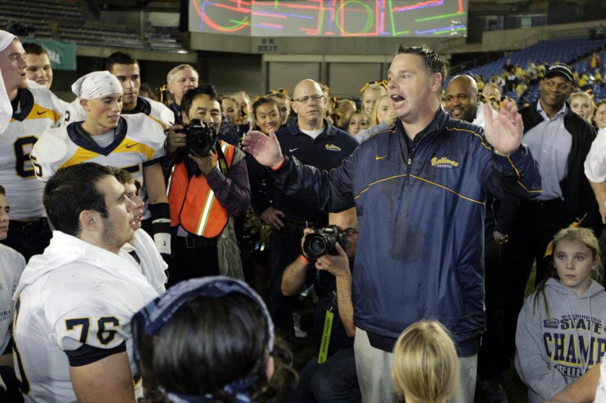 Bellevue High School football coach Butch Goncharoff addresses his team after winning the Class 3A state championship in 2012. (Ted S. Warren/Associated Press)