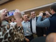 Republican presidential candidate Sen. Ted Cruz poses with Nolan Latham, a delegate from Sweetwater county, after a speech during the Wyoming GOP Convention on Saturday, April 16, 2016, at the Parkway Plaza Hotel and Convention Centre in Casper, Wyo.
