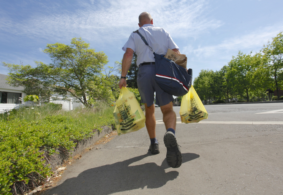 letter carrier jeff lovell picks up food donations along his route in vancouver during last year