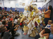 Bagzilla wows the crowd Friday at Mill Plain Elementary School's celebration for beating 20 other local schools that participated in the Trex Plastic Film Recycling Challenge.