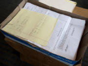 A box of signed petitions is seen May 1 at Vancouver City Hall.