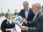Gov. Jay Inslee, center, tours the future Vancouver waterfront park with the project's developer, Barry Cain, right, and Sen. Annette Cleveland, D-Vancouver, on Wednesday. Inslee said the project will benefit the entire state.