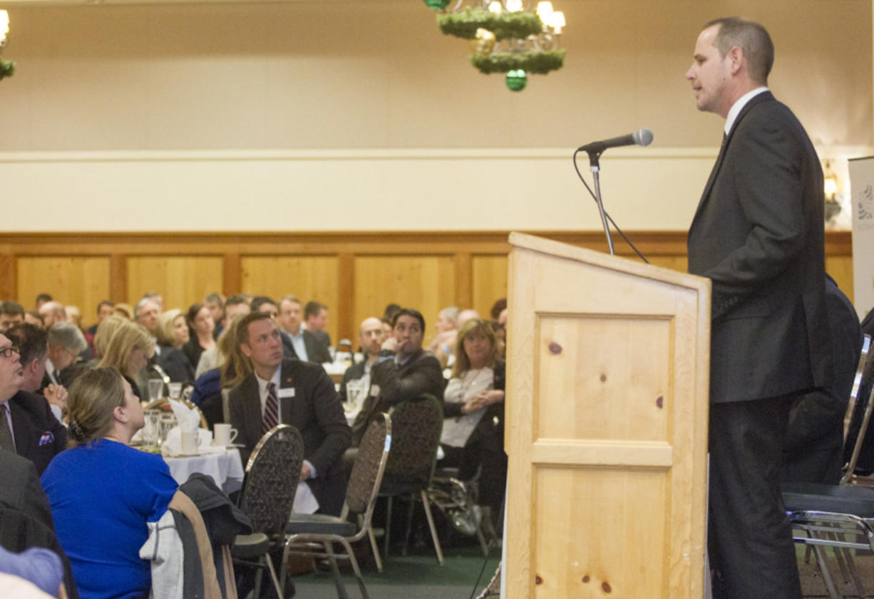 """Todd Coleman, then-CEO of the Port of Vancouver, speaks at a luncheon for the Columbia River Economic Development Council in December 2014 at the Heathman Lodge in Vancouver. The CREDC hosted a panel discussion, """"The Value of Vision,"""" featuring representatives from the Port of Vancouver and the cities of Vancouver, Camas and Ridgefield."""