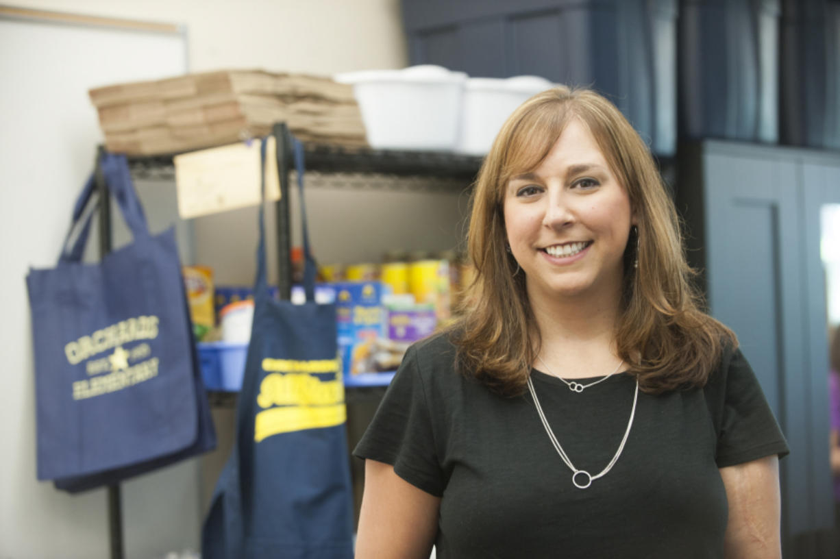 Melanie Green from Evergreen Public Schools, oversees the district's 10 family and community resource centers. She has been named the state's Classified School Employee of the Year.