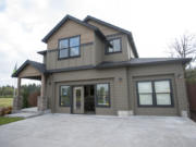 This new house in Brush Prairie includes a great room and a first-floor office/guest room, two popular features in new homes.