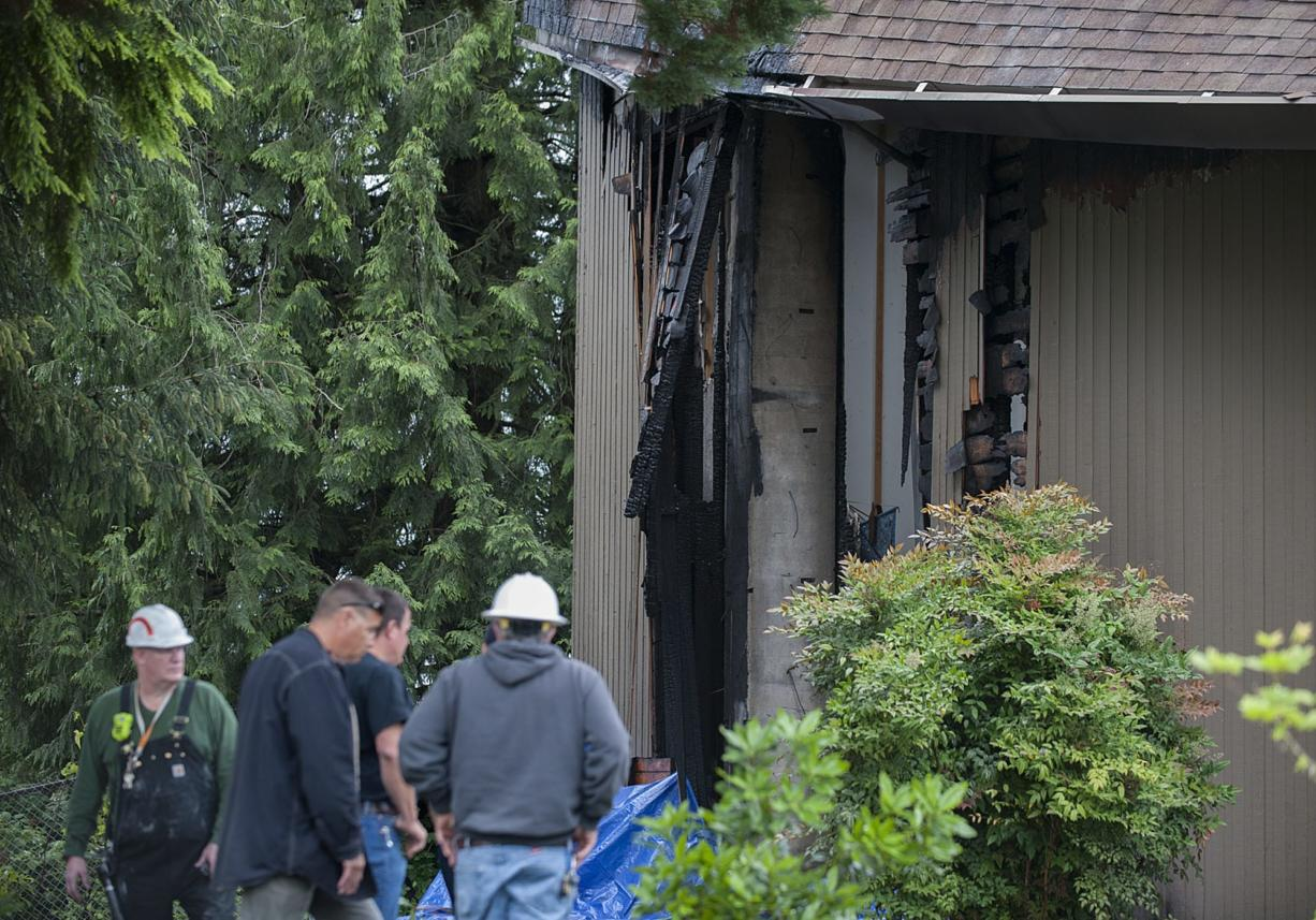 Firefighters and onlookers gather at the First Congregational United Church of Christ after a fire damaged the building Wednesday morning in Hazel Dell.