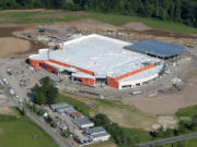 As seen in this aerial photo taken Friday morning, construction on the new Cowlitz casino along Interstate 5 at Exit 16 is about 40 percent complete, according to the Cowlitz Tribe. Clark County health officials are recommending the casino hook up to the city of La Center's sewer system out of public health necessity.