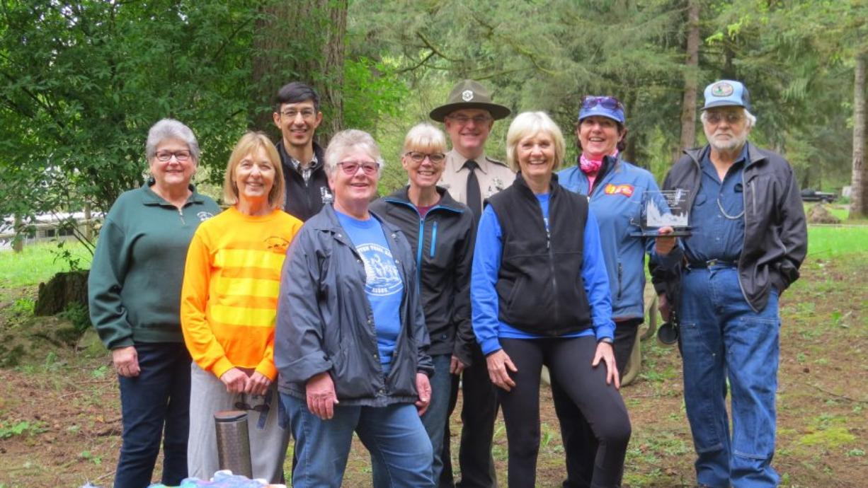 Battle Ground: Judy Smith, from left, Nancy Rust, Ryan Ojerio, Barbara Thomas, Claire Fisher, Chris Guidotti, Ruth Colonnello, Leith Dist and Ted Klump at Battle Ground Lake state park. The Washington Trail Riders received an award for their work on the park's trails.
