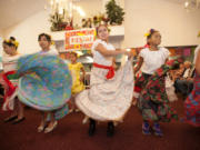 Students from Pioneer Elementary School's Dual Immersion dance troupe the Mexican Dancers celebrate Cinco de Mayo with a festive dance at Kamlu Retirement Inn.