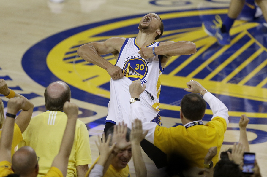 8894f4122 Fans cheer as Golden State Warriors guard Stephen Curry yells after the  Warriors beat the Oklahoma