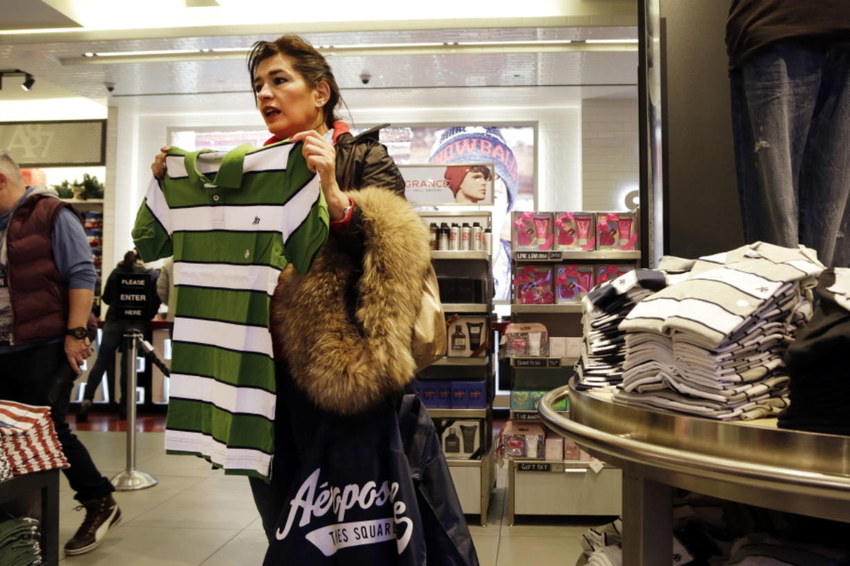 A woman shops in December at an Aeropostale clothing store in New York. Aeropostale has joined the ranks of teen merchants filing for bankruptcy protection. But the once-popular mall destination for teens has struggled for years for several reasons.