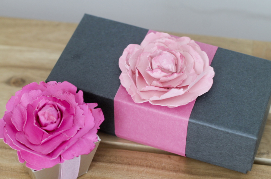 Flowers made from paper a fun way to add unexpected pop the columbian flowers made out of cardstock are used to adorn gift boxes while this technique results mightylinksfo