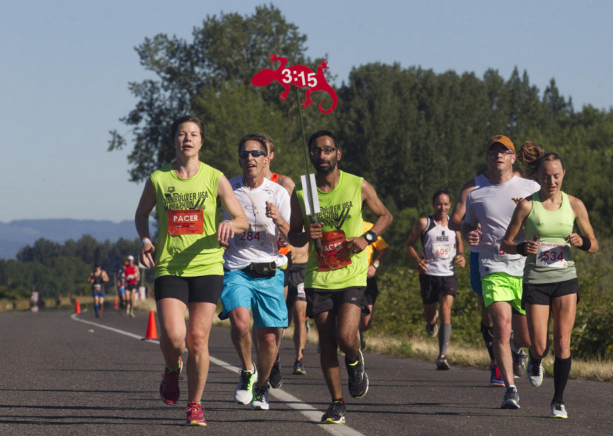 Runners take part in the Vancouver Marathon, near Vancouver Lake Sunday June 19 2016.