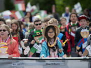 Lake Shore Elementary School third-grader Madison Nguyen, 9, center, honors the country of Vietnam while leading classmates along the parade route  May 27 at Fort Vancouver National Historic Site.