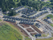 New homes under construction are seen in May near Woodburn Elementary School in Camas. The city gained about 600 residents from April 2015 to April 2016.