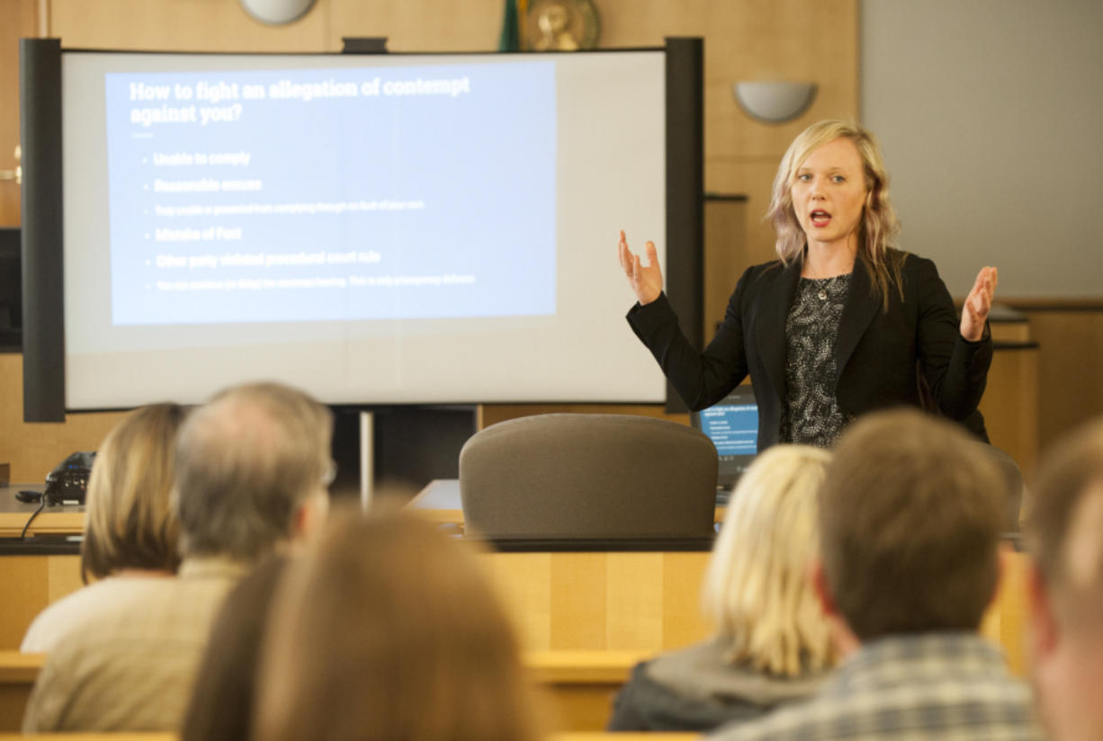 Vancouver attorney Amber Rush of Navigate Law Group teaches a free class on maneuvering through the family law system June 14 at the Clark County Courthouse. Several attorneys and court employees attended the noon-hour clinic, which is designed to help the public.