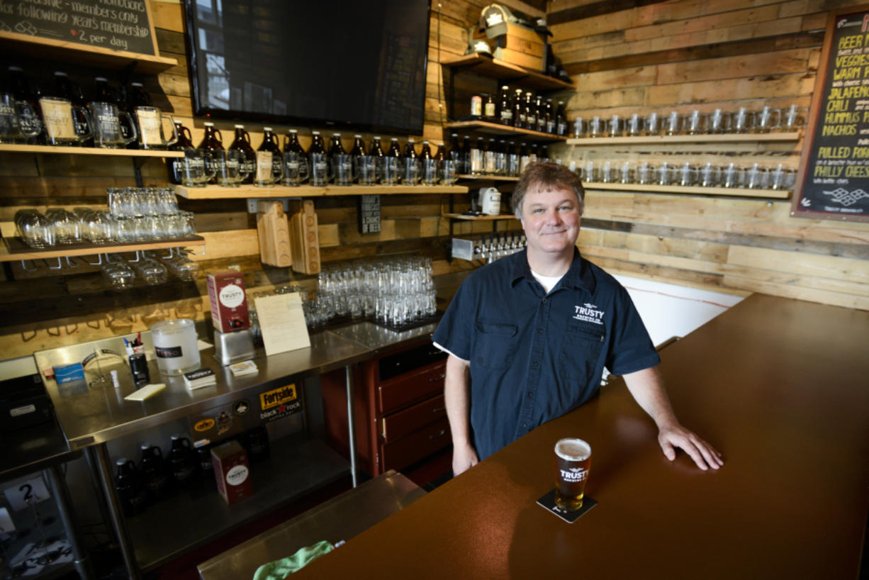 Gary Paul, a longtime home brewer, opened Trusty Brewing Co. with his wife, Andrea, earlier this year at the corner of Evergreen Boulevard and Broadway.