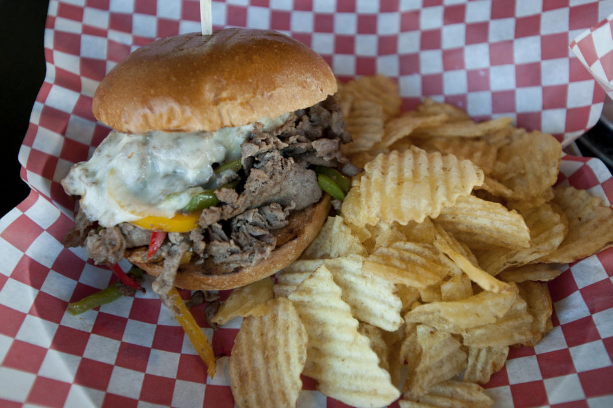 A Philly cheesesteak is served June 3 at Trusty Brewing Company in downtown Vancouver.
