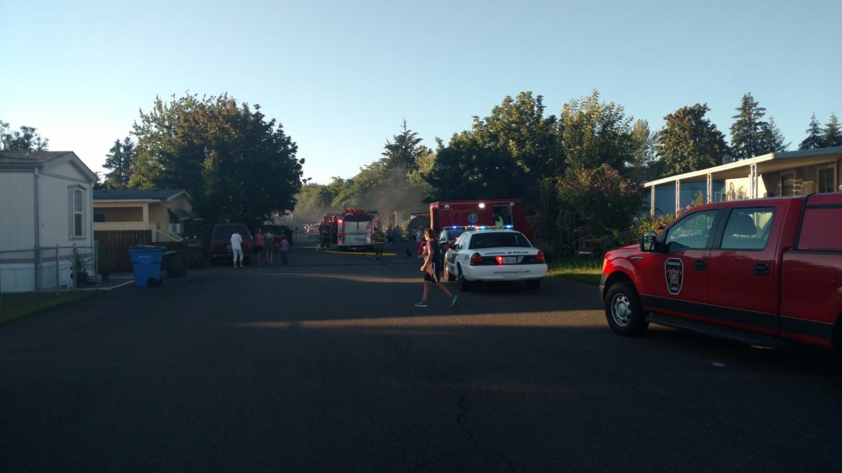 A fire burns at a home at Gibbon Creek Mobile Estates in Washougal Tuesday night.