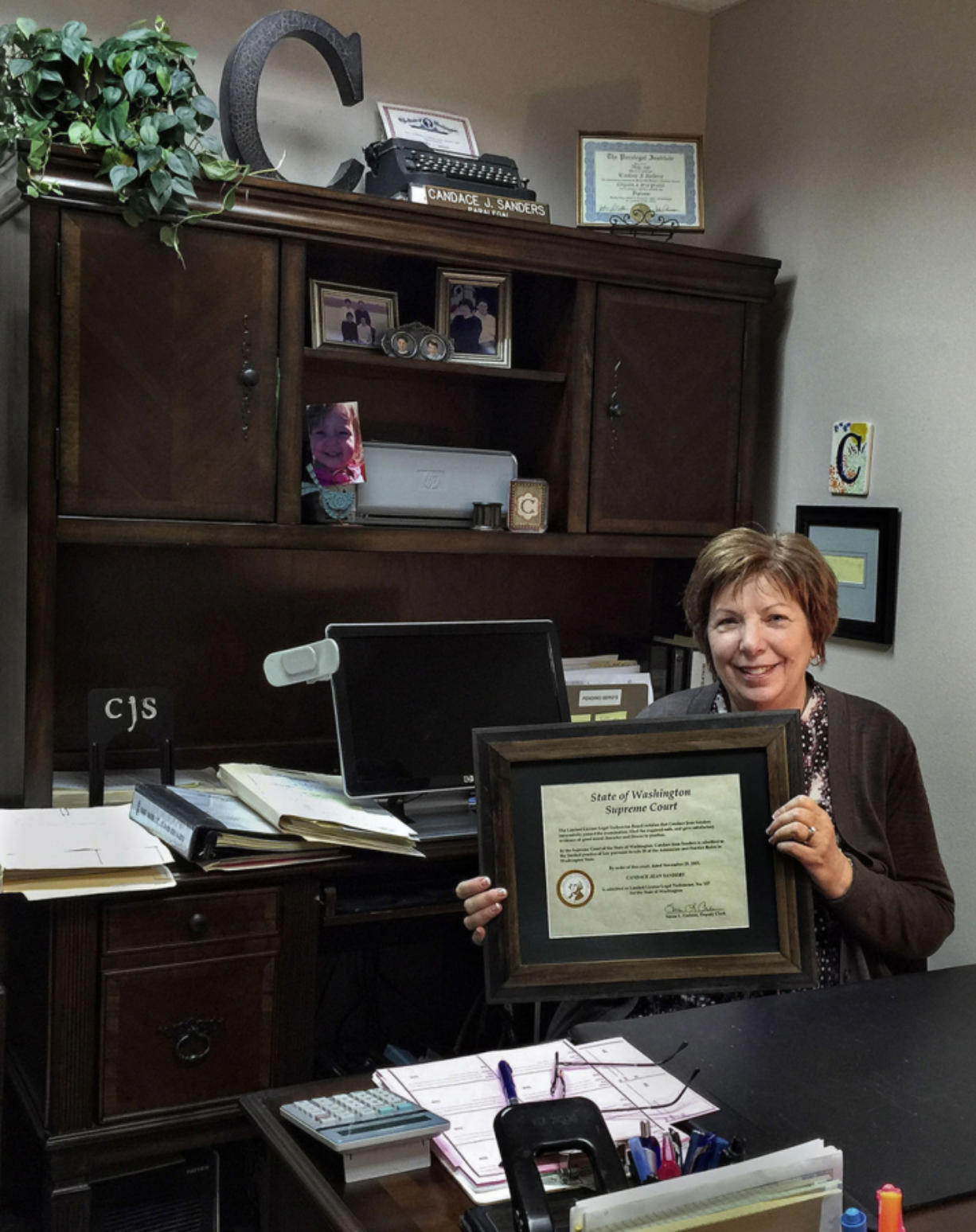 Candace Sanders displays her Limited License Legal Technician certificate in her Longview office in January. It allows her to provide family legal assistance with no law degree.