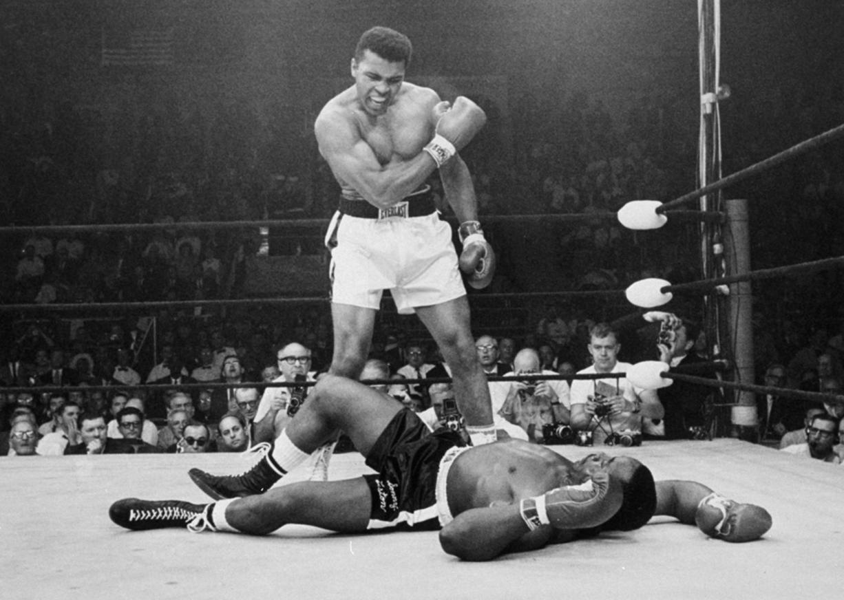 Muhammad Ali Dies at 74: Titan of Boxing and the 20th Century