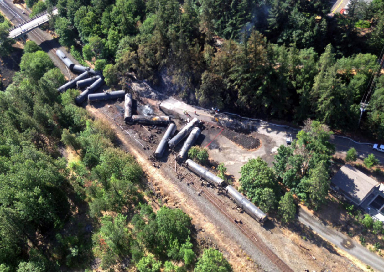 This aerial view provided by the Washington State Department of Ecology shows scattered and burned oil tank cars June 4 after a train derailed and burned near Mosier, Ore. Union Pacific Railroad said it had recently inspected the section of track near Mosier, about 70 miles east of Portland, and that it had been inspected at least six times since March 21.