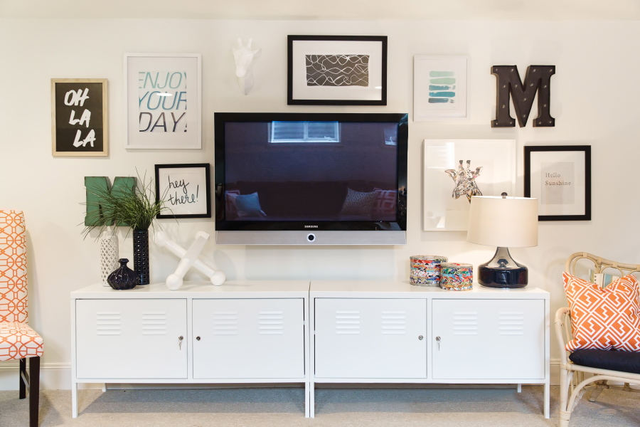 A Television Creatively Mounted On The Wall That Keeps It From Standing Out Too Much Or