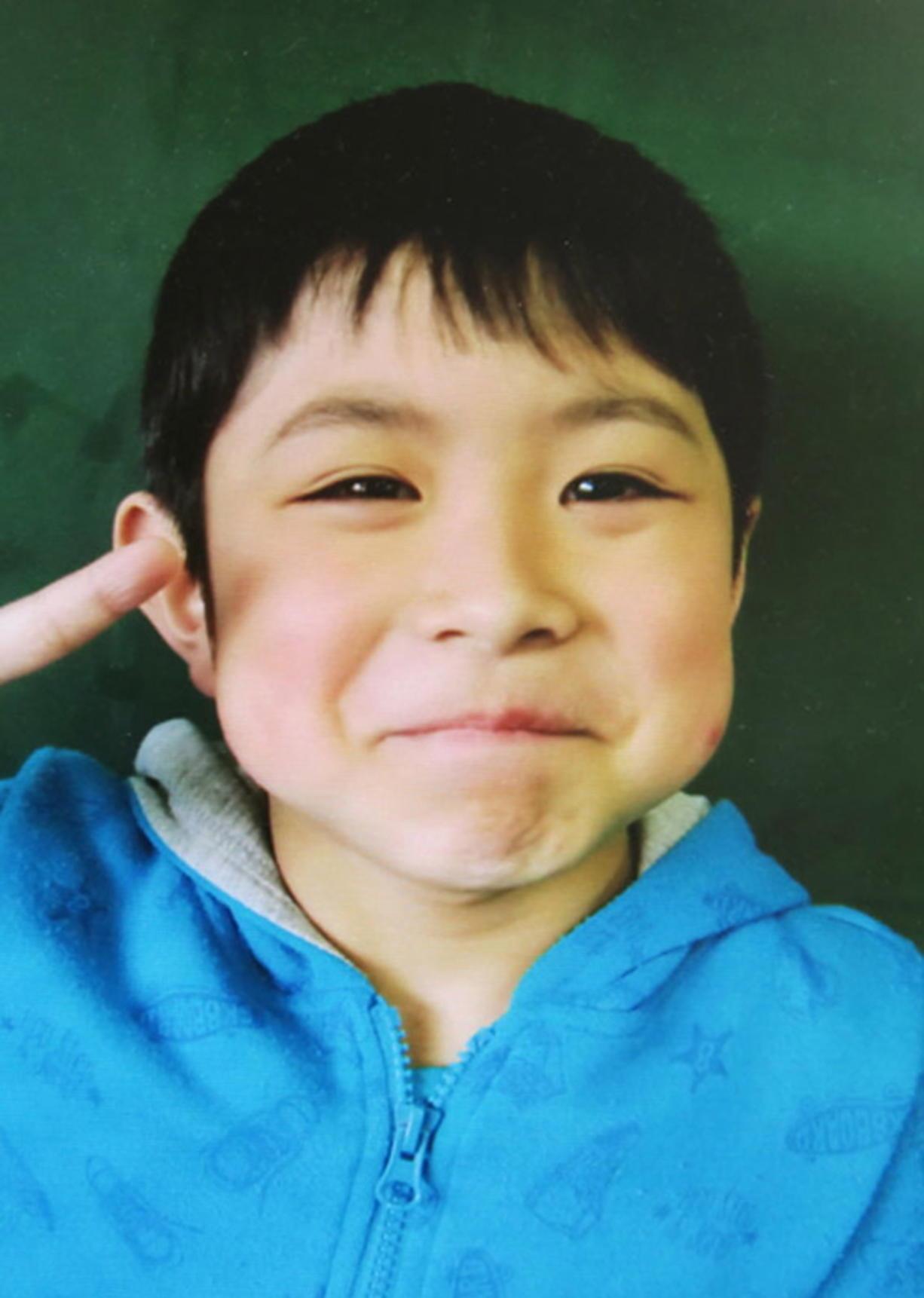 Japan praises boy who survived alone, wonders about parents