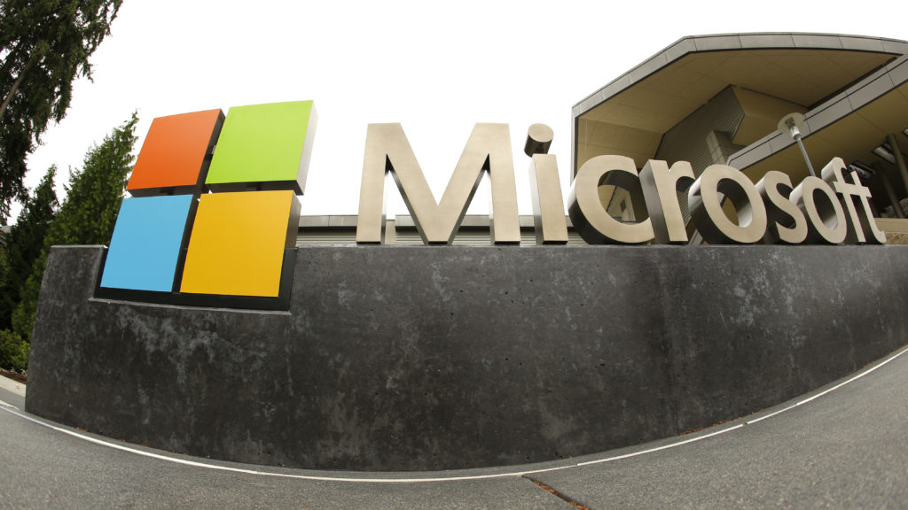 The Microsoft Corp. logo outside the Microsoft Visitor Center in Redmond, Wash. Microsoft said Monday, June 13, 2016, it is buying professional networking service site LinkedIn for about $26.2 billion. LinkedIn, based in Mountain View, Calif., has more than 430 million members. (AP Photo Ted S.