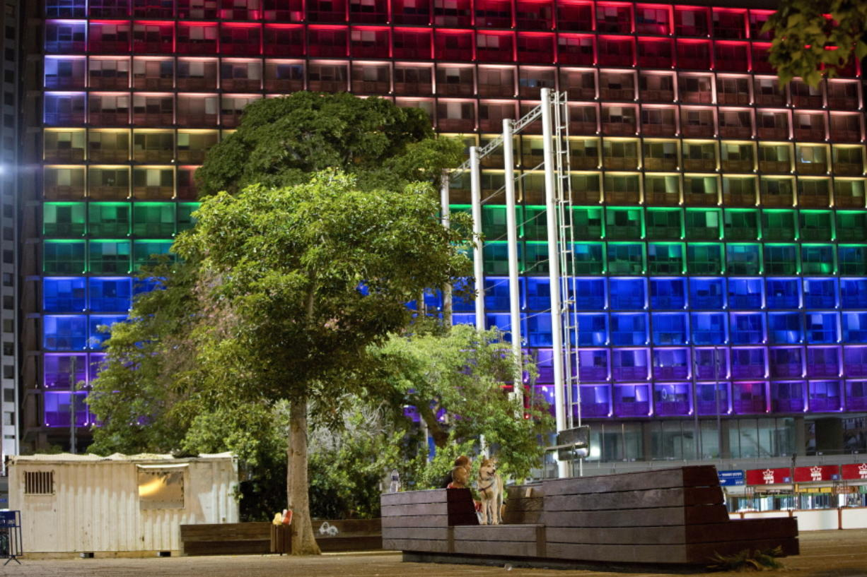 Tel-Aviv city hall lit up with rainbow flag colors in solidarity with Florida's shooting attack victims, in Tel Aviv, Israel, on Sunday.  The shooting attack in Orlando, Fla., on Sunday left more than 50 people dead amid a multitude of events celebrating LGBT Pride Month. (AP Photo/Oded Balilty)
