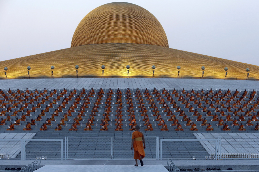 Thai Buddhist monks gather at the gates of the main temple of Wat  Dhammakaya to participate 169acf363