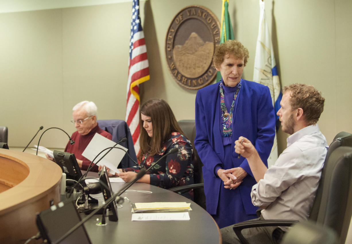Salary Review Commission members Barry Hemphill, from left, Magan Reed, MarCine Miles and Thomas Hackett gather before the April 15 meeting at City Hall. (Amanda Cowan/The Columbian)