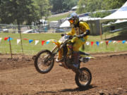 Antonio Atiyoot, a 13-year-old from Thailand, races in a 85cc motocross race Thursday at Washougal Motocross Park.