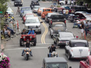 New and vintage cars, and motorcycles move bumper to bumper up and down Main Street in Vancouver during the annual Cruisin' the Gut event.