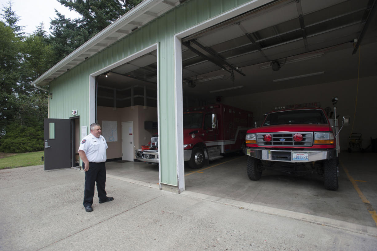 Clark County Fire & Rescue Division Chief of Operations Mike Jackson stands outside Fire District 2's fire station, which is used for storage since nobody operates out of it at the moment. It was previously used by volunteers who came from the former Woodland Fire Department. District 2 residents will vote on a potential merger with Clark County Fire & Rescue on Aug. 2. (Amanda Cowan/The Columbian)